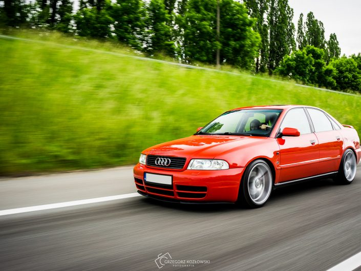 Red Audi A4 B5 rolling shot S4 front